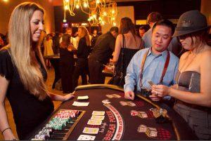 Nikki of Ace High Casino Rentals dealing a Caribbean Poker game